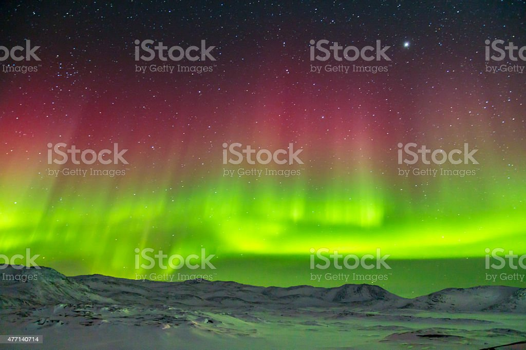 Spectacular red and green Aurora Borealis Northern Lights in Greenland stock photo
