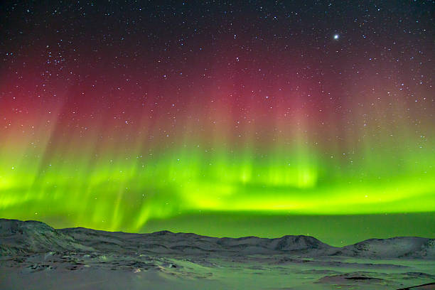 Rote und grüne Aurora Borealis Northern Lights in Grönland – Foto