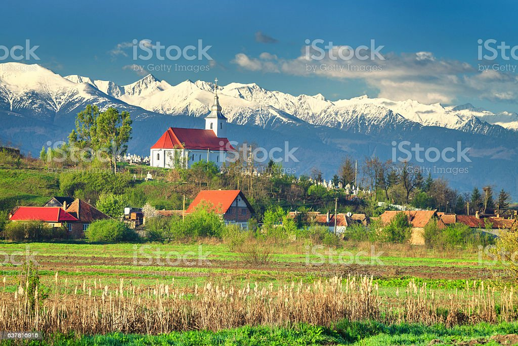 Spectacular rural spring landscape and snowy mountains, Transylvania, Romania, Europe stock photo