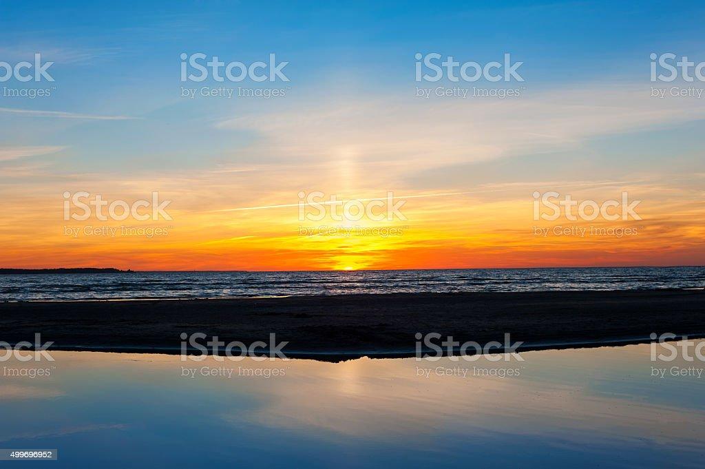 Spectacular summertime sunset on Baltic sea beach. Horizontal outdoors image stock photo