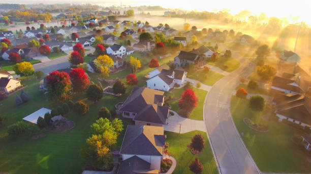 spectacular sunbeams through fog in autumn neighborhood, aerial view. - green bay wisconsin stock photos and pictures