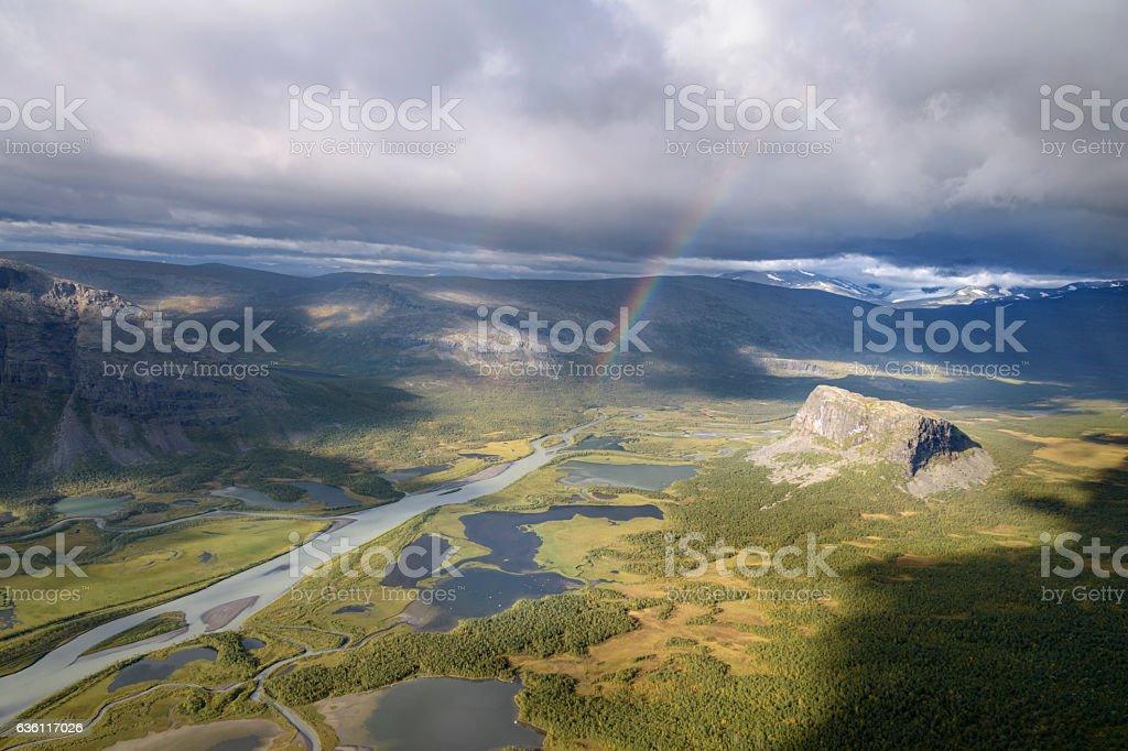 Spectacular sunlight on autumn landscape and rainbow in mountain scenery foto