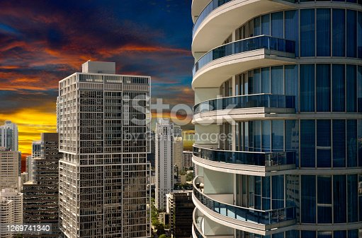 Spectacular Sunrise behind the urban landscape is shown in this view of the Miami skyline looking South from the 40th floor of a building in the center of the city. High rise, luxury office buildings and condominiums paint the landscape.