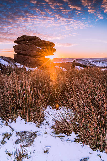 spectacular sunrise on rocky hill mountain at snowy morning - outcrop stock pictures, royalty-free photos & images