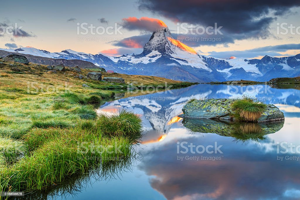 Spectacular sunrise with Matterhorn peak and Stellisee lake,Valais,Switzerland stock photo
