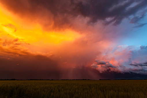 Spectacular sunset colours on storm clouds in US Mid-West Tornado Alley.  Horizontal, copy space.