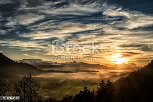 istock spectacular sunset over landscape at European alps in winter 501263476