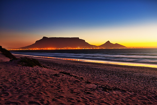 Scene after sunset looking towards Cape Town's famous Table Mountain from the coastline at Blouberg.