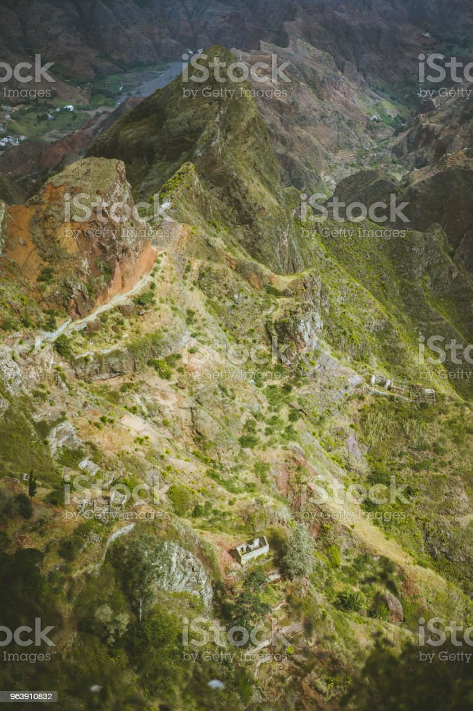 Spectacular view above sharp mountain ridge. Green valleys stretch down both sides of the ridge. Trail to Caculi Cape Verde Santo Antao - Royalty-free Adventure Stock Photo
