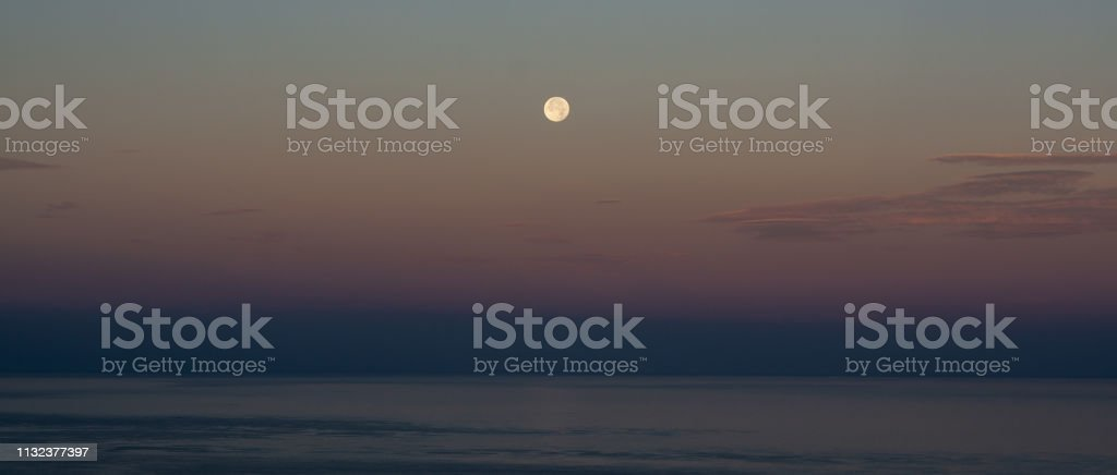 spectacular view from a great moon over the sea