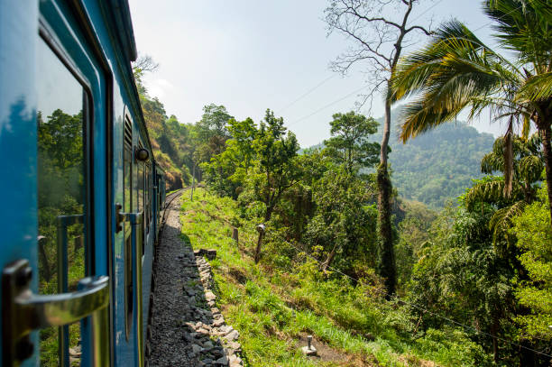Spectacular view through the train window connecting Kandy to Ella in Sri Lanka. The train trip from Ella to Kandy in Sri Lanka, or the other way around, is considered to be one of the most beautiful train trips in the world. stock photo