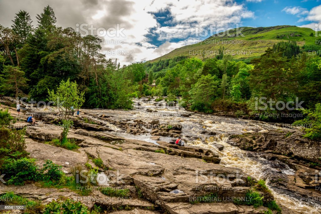 A spectacular view to Falls of Dochart from the bridge in a town of Killin, central Scotland stock photo
