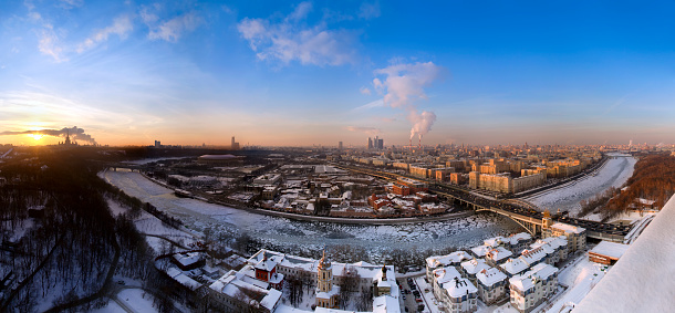 Moscow Cityscape with Moscow river, bridges, Seven Sister buildings, Moscow International Business Center, Cathedral of Christ the Saviour,  Moscow State University and other famous buildings and placessunset