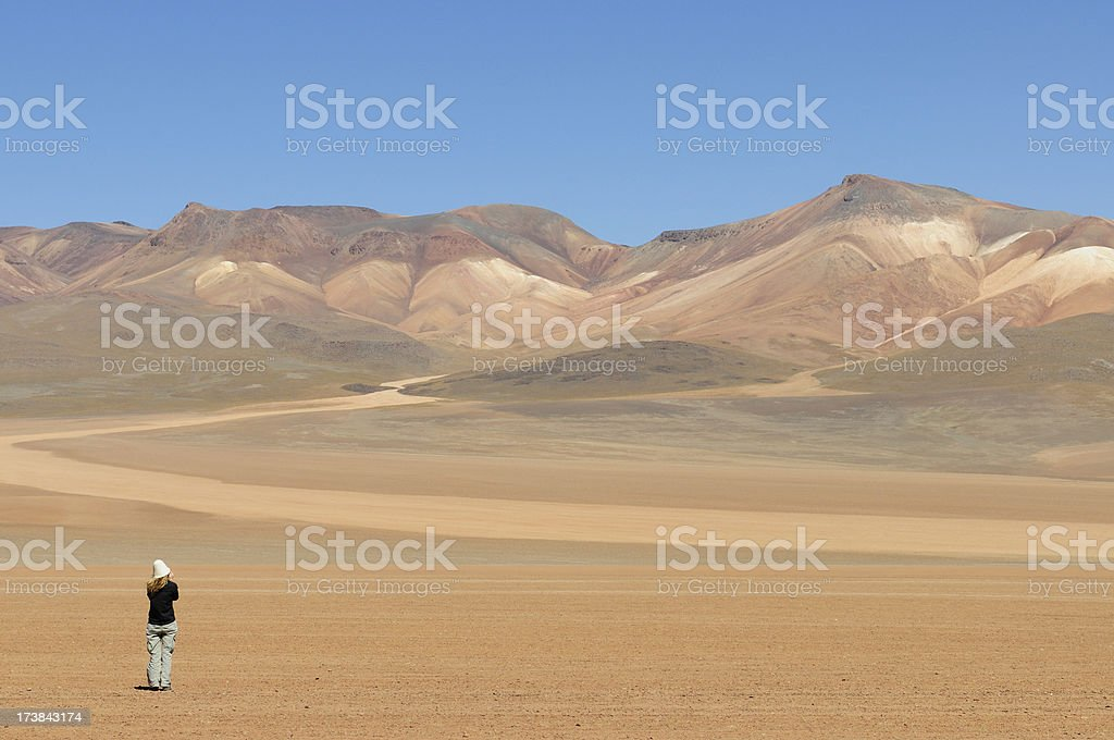 Spectator at Mountain of the Seven Colors, Bolivia royalty-free stock photo