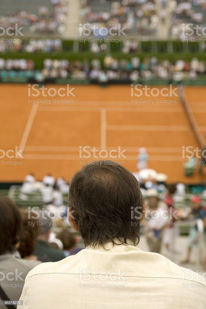 Spectator watching tennis match stock photo