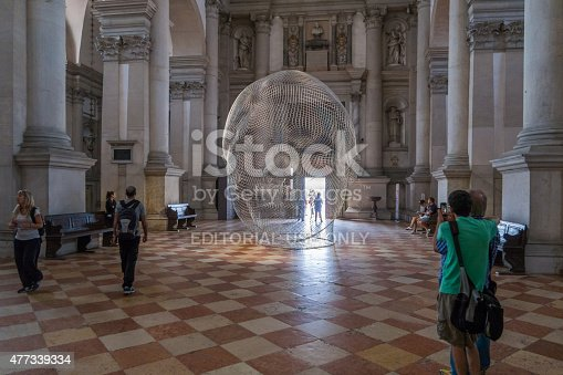 Venice, Italy - May 19, 2015: Spectators admire artwork entitled 'Together' by artist Jaume Plensa in the Basilica of San Giorgio Maggiore at the 56th Venice Biennale.
