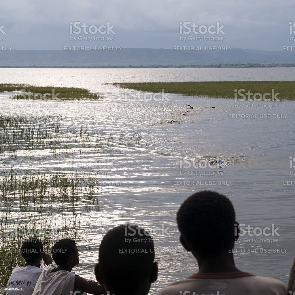 Spectators and Swimmers on Lake Awasa stock photo