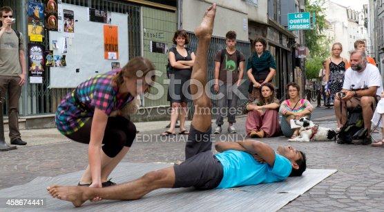 istock Spectators around two street performers. 458674441