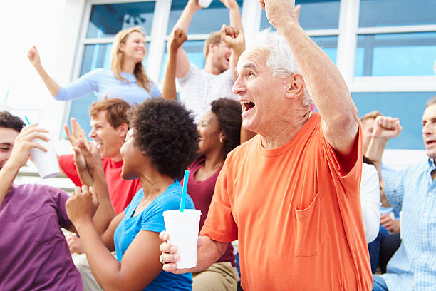 spectators cheering at outdoor sports event - sports event stock photos and pictures