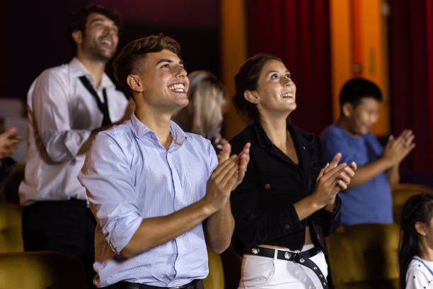 Spectators clapping hands after show stock photo