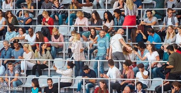 Crowd sitting in stadium.
