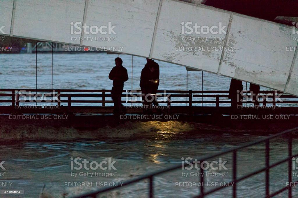 Spectators on lower deck of flooded Centre Street Bridge royalty-free stock photo