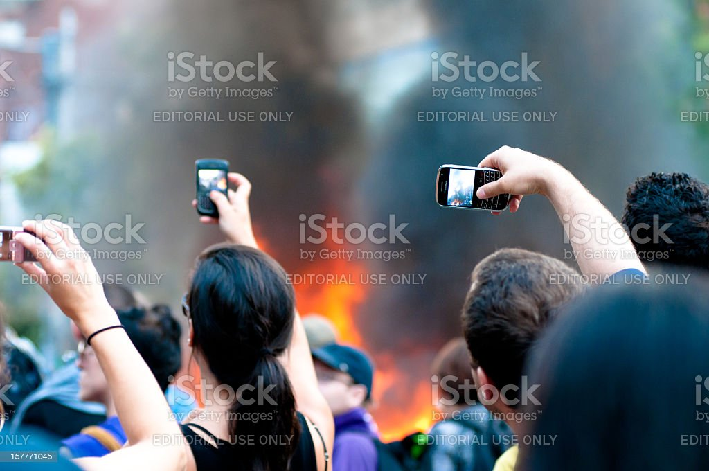 Spectators recording a fire stock photo