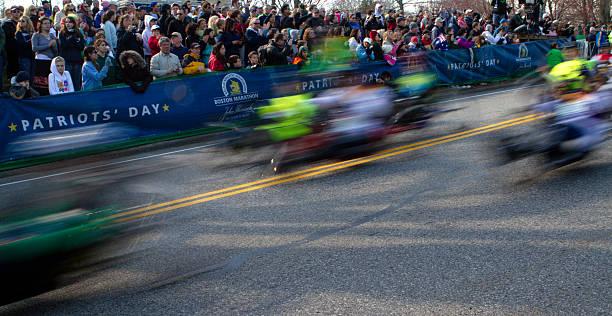 spectators watch participants of the boston marathon start the event - boston marathon stock photos and pictures