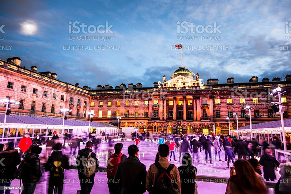 Spectators watching People Ice Skating at Somerset House, London stock photo