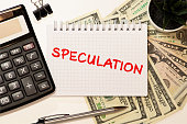 istock Speculation memo written on a notebook with pen 1283094117