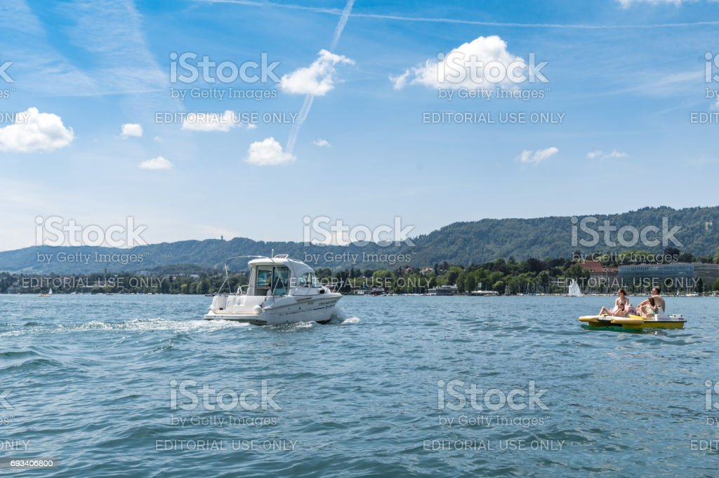 Spedeboat and Pedalo on Lake Zurich stock photo