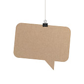 A  3D representation of a speech bubble hanging on a plain white background. The speech bubble is hanging from a binder paper clip that is attached to a piece of string. The bubble has a cardboard texture. The background is pure white. You can add your own message to the speech bubble
