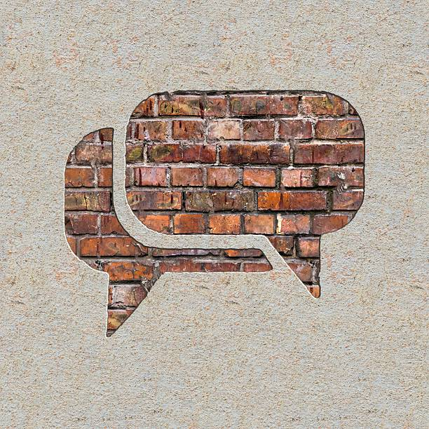 Speech Bubble Icon on the Wall. Speech Bubble Icon on the Brick and Plastered Wall. boundary stock pictures, royalty-free photos & images