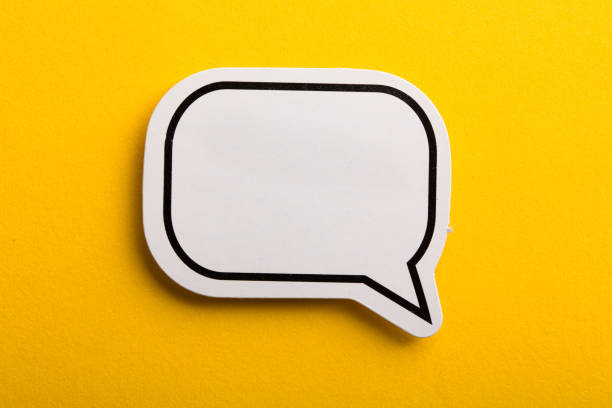 speech bubble isolated on yellow background - orthographic symbol stock pictures, royalty-free photos & images