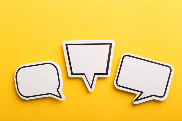 Speech Bubble Isolated On Yellow Background Blank white speech bubble isolated on yellow background. speech bubble stock pictures, royalty-free photos & images
