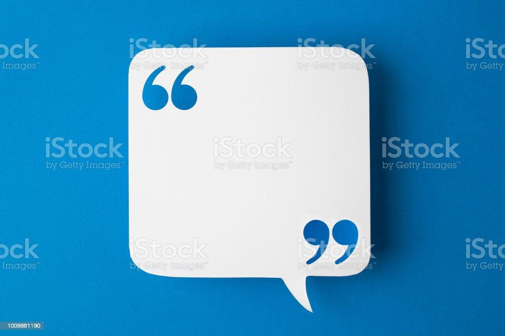 speech bubble on blue background stock photo