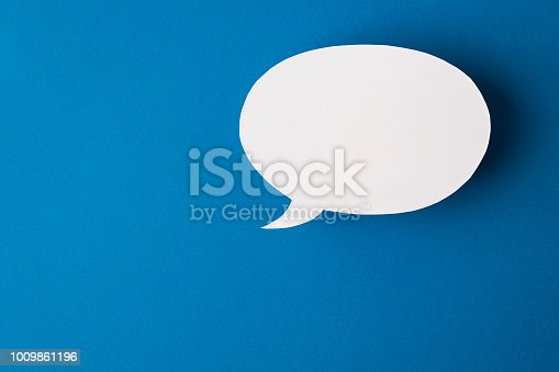 istock speech bubble on blue background 1009861196