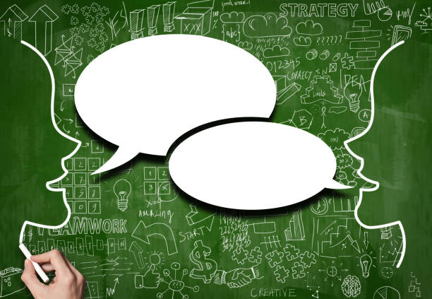 Speech bubble on green board with charts on background (Click for more) stock photo