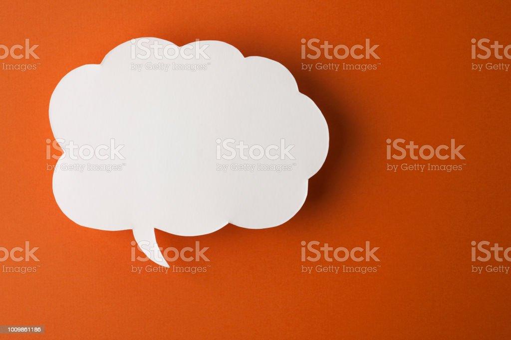 speech bubble on orange background stock photo