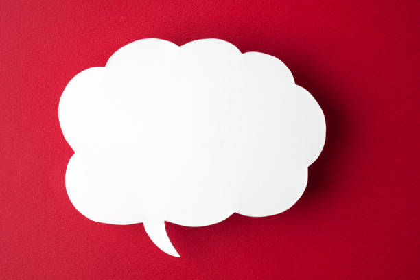 speech bubble on red background - thought bubble stock photos and pictures