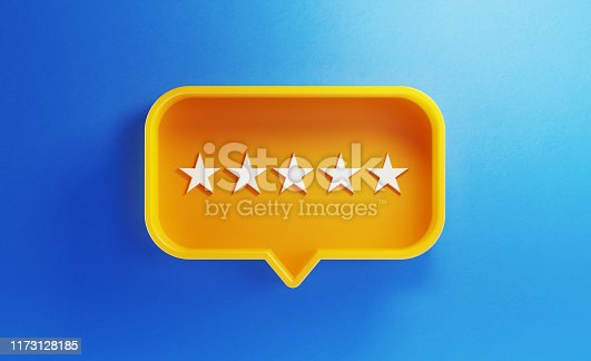 istock Speech Bubble Shaped Yellow Button with Five Stars on Blue Background 1173128185