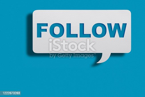 istock Speech Bubble With Follow Us Message On Blue Background With Clipping Path 1222670263