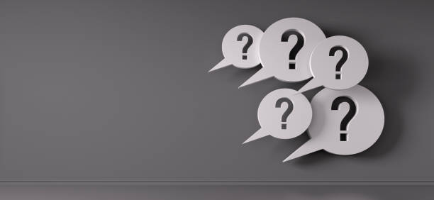 Speech bubble with question mark Speech bubbles with question mark against gray wall faq stock pictures, royalty-free photos & images