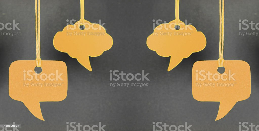 Speech bubbles hanging in orange color stock photo