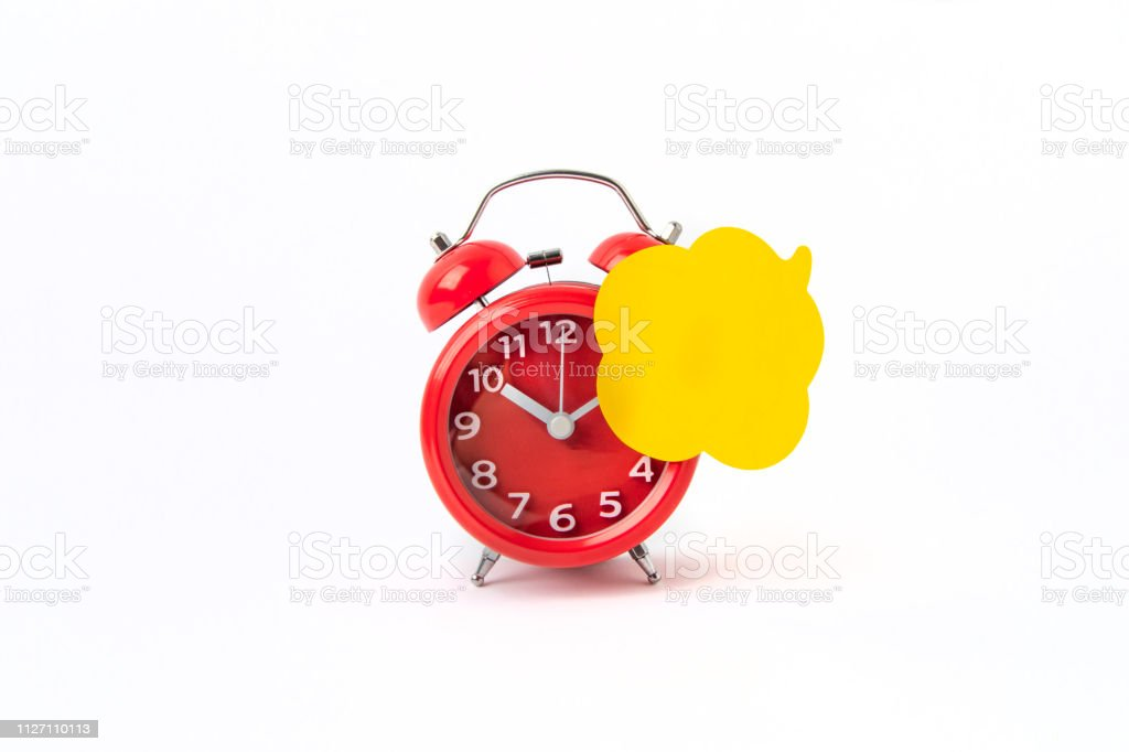 Speech bubbles On Alarm Clock with white Background stock photo