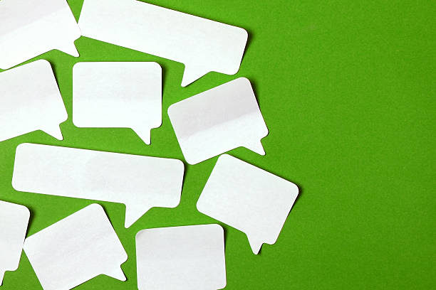 Speech bubbles on green stock photo