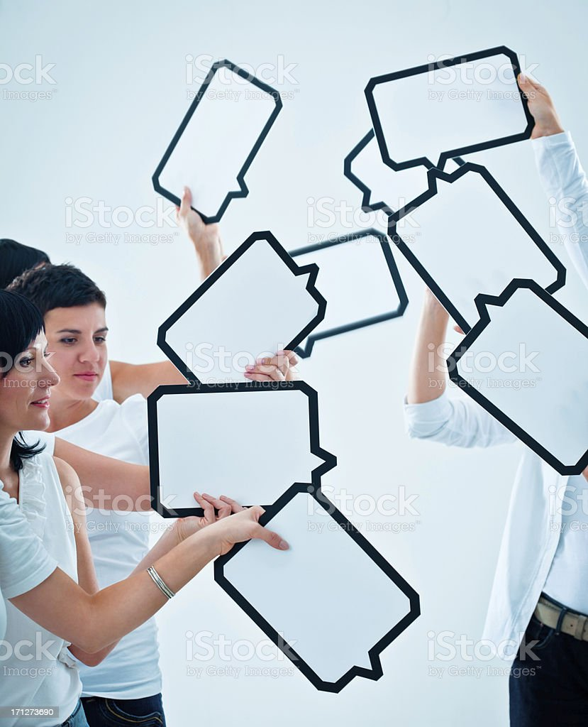 Speech bubbles Group of women holding many speech bubbles with copyspace in thier hands. 30-34 Years Stock Photo