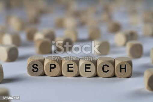 speech - cube with letters, sign with wooden cubes