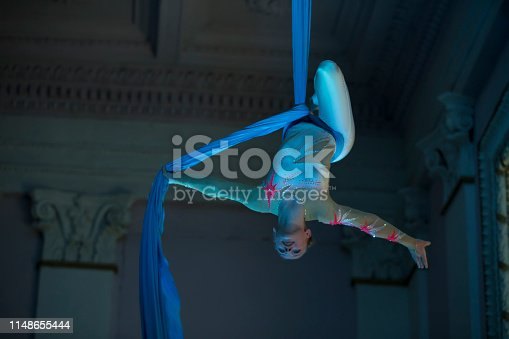 istock Speech gymnasts on the canvases. Girl on acrobatic canvases.Dangerous Circus Tricks.Aerial gymnast 1148655444