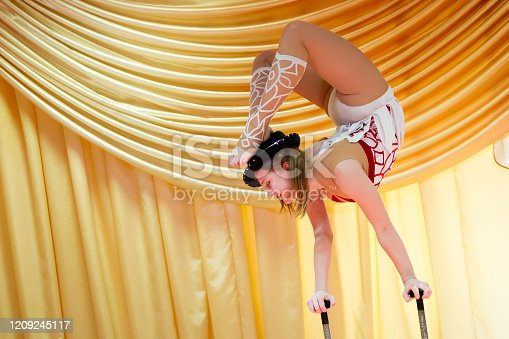 629965740 istock photo Speech of the people's circus Abel.Equilibrizer.Flexible female acrobat 1209245117